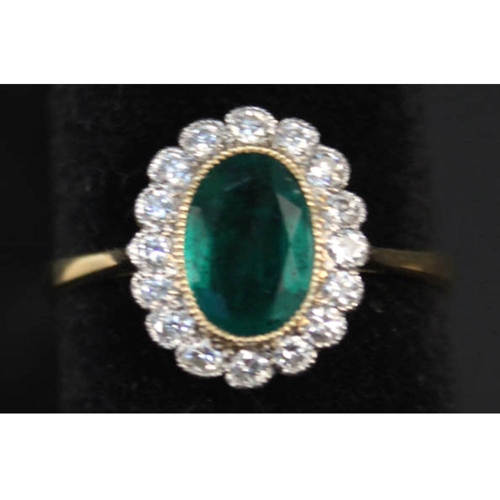Lot 222 - An 18th gold emerald and diamond cluster ring, Estimate £250-350