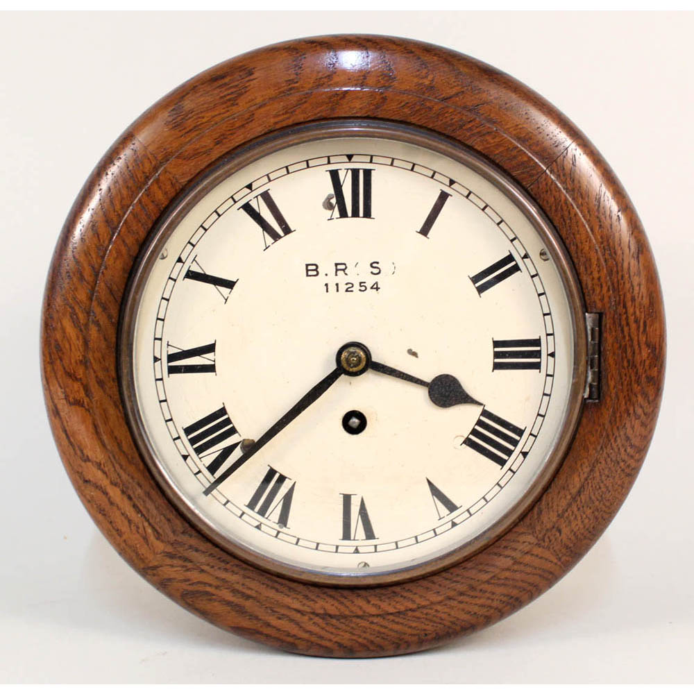 Lot 53 - A railway circular oak fusee wall clock marked B.R.(S), Estimate £300-500